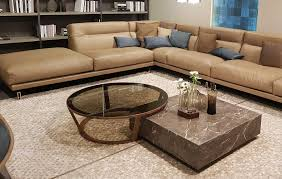Things to consider while buying wood and glass coffee table